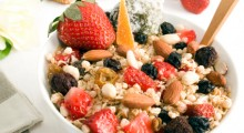 Granola bowl: oats, rice, honey, peanuts, almonds, waxberry, white and red raisins, & strawberries.