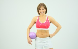 Shannon Miller with exercise medicine ball.