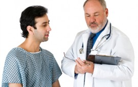 Doctor and male patient at physical exam.