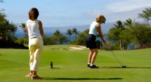 Ladies playing golf for fun and exercise.