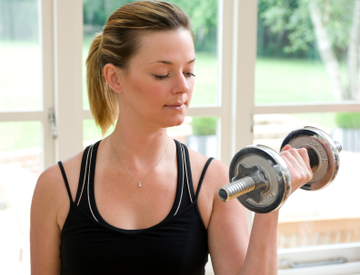 Young Lady Doing Biceps Curls