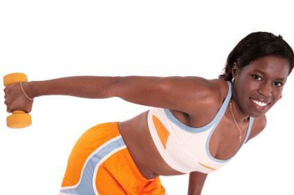 Young Lady Doing Triceps Kick-backs