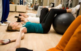 Friends exercising at Pilates class.