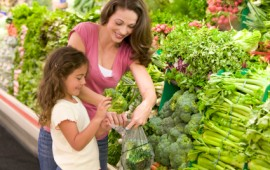 Mother and daughter shopping for healthy foods
