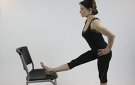 Shannon Miller stretching with chair