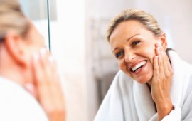 woman-in-mirror-healthy-skin