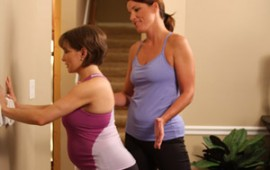Shannon Miller doing plank while pregnant, with Jackie Culver.